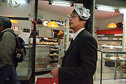 Japanese male adult walking with an animation mask on his head during Torino no Ichi