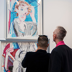 © Licensed to London News Pictures. 22/04/2015. Piccadilly, London. Members and guests at the press review look at items on display at the 30th London Original Print Fair, Europe's largest works–on–paper event, which takes place at the Royal Academy of Arts from 23 to 26 April 2015.  On display are works from all periods of printmaking, from the earliest woodcuts of Dürer, to the latest editions by contemporary masters. Photo credit : Stephen Chung/LNP