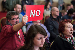 "© Licensed to London News Pictures . 18/11/2014 . Kent , UK . Audience member voting "" NO "" in response to a question at a hustings in the Rochester and Strood by-election , held at the Corn Exchange in Rochester , this evening ( 18th November 2014 ) . Photo credit : Joel Goodman/LNP"