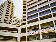 13 DECEMBER 2018 - SINGAPORE:  the Joo Chiat complex. Joo Chiat is a multi-tower high rise residential estate. There are hawker food stalls and retail businesses on the ground floor and residences on the upper levels.  The Geylang area of Singapore, between the Central Business District and Changi Airport, was originally coconut plantations and Malay villages. During Singapore's boom the coconut plantations and other farms were pushed out and now the area is a working class community of Malay, Indian and Chinese people. In the 2000s, developers started gentrifying Geylang and new housing estate developments were built.      PHOTO BY JACK KURTZ