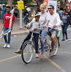 A local gets a lift on King Langalibalele Street during the Open Streets Langa event on 30 October 2016, when the street was closed to motorised vehicles and opened to people. Hosted by Open Streets Cape Town and supported by the City of Cape town and WWF. photo by John Tee/RealTime Images.