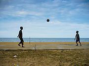 15 JUNE 2105 - BAN THONG, NARATHIWAT, THAILAND:   Boys kick a soccer ball on a basketball court at Ban Thong beach in Narathiwat, Thailand.      PHOTO BY JACK KURTZ