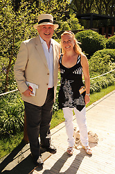 Th 2010 Royal Horticultural Society Chelsea Flower show in the grounds of Royal Hospital Chelsea, London on 24th May 2010.<br /> <br /> Picture shows:- CHRISTOPHER BIGGINS and JAYNE TORVILL