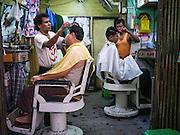16 JUNE 2013 - YANGON, MYANMAR:  A barbershop in Yangon. Yangon, formerly Rangoon, is the largest city in Myanmar. It is the former capital of the Southeast Asian country. It's still Myanmar's economic capital.      PHOTO BY JACK KURTZ