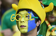 A dejected fan of Brazil during the 2014 FIFA World Cup match at Mineirão, Belo Horizonte<br /> Picture by Stefano Gnech/Focus Images Ltd +39 333 1641678<br /> 08/07/2014