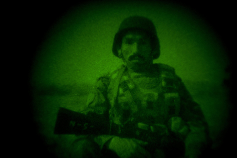 An Afghan National Army lieutenant photographed through a night vision device.