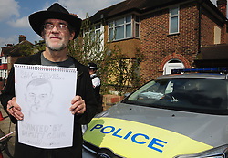 © Licensed to London News Pictures.14/04/2018<br /> HITHER GREEN, UK.<br /> Artist and protester Iain Gordon with his wanted poster of Billy Jeeves outside the home of Richard Osborn-Brooks.<br /> A one man protest in Hither Green with local resident Iain Gordon holding a demo of his own.<br /> Community Support for the Residents of South Park Crescent a<br /> peaceful protest outside the home of 78 year old Richard Osborn-Brooks who stabbed and killed burglar Henry Vincent.<br /> Photo credit: Grant Falvey/LNP