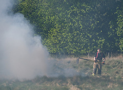 Firefighters extinguish a wild fire, 06 May 2020<br /> <br /> Pictured: Firefighters extinguish a wild fire in Mid Calder, Livingston<br /> <br /> <br /> Alex Todd | Edinburgh Elite Media