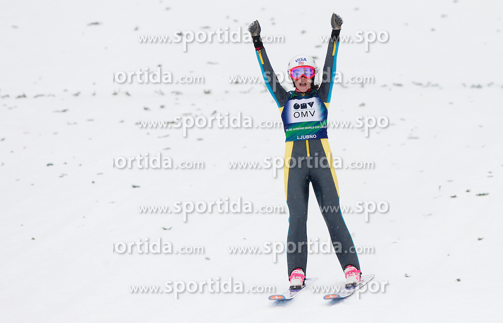 Winner Sarah Hendrickson of USA celebrates during Normal Hill Individual Competition at FIS World Cup Ski jumping Ladies Ljubno 2012, on February 12, 2012 in Ljubno ob Savinji, Slovenia. (Photo By Vid Ponikvar / Sportida.com)