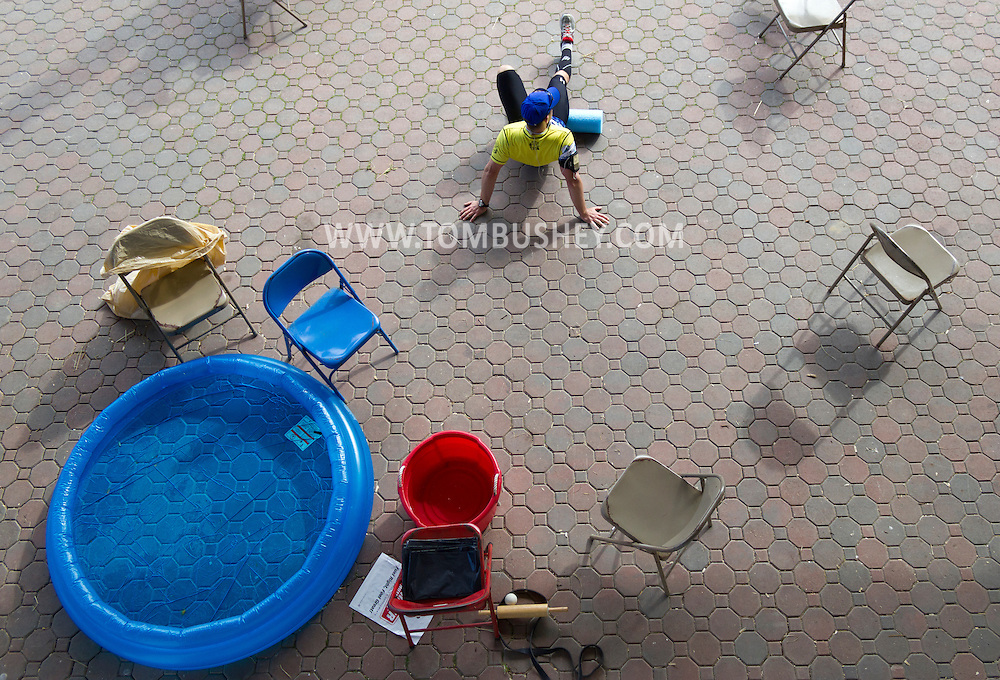 Augusta, New Jersey - A runner rests during the 3 Days at the Fair races at Sussex County Fairgrounds on May 11, 2012. The runner used the pool to cool off during the race.
