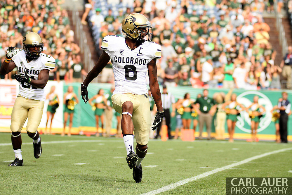 September 1st, 2013 - Colorado Buffaloes junior wide receiver Paul Richardson (6) celebrates after scoring a 82 yard touchdown reception in the first half of action in the NCAA football game between the Colorado Buffaloes and the Colorado State Rams at Sports Authority Field in Denver, CO