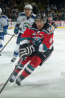 KELOWNA, CANADA - OCTOBER 7:Madison Bowey #4 of Kelowna Rockets skates against the Swift Current Broncos on October 7, 2014 at Prospera Place in Kelowna, British Columbia, Canada.  (Photo by Marissa Baecker/Getty Images)  *** Local Caption *** Madison Bowey;