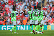 Nigeria forward Alex Iwobi (18) is congratulated by teammates after scoring a goal(2-1to England) during the Friendly International match between England and Nigeria at Wembley Stadium, London, England on 2 June 2018. Picture by Toyin Oshodi.
