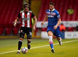 Kieron Freeman of Sheffield United goes past Ramadan Sobhi of Stoke City - Mandatory by-line: Robbie Stephenson/JMP - 25/07/2017 - FOOTBALL - Bramall Lane - Sheffield, England - Sheffield United v Stoke City - Pre-season friendly