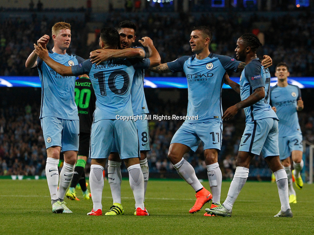 14.09.2016. The Etihad, Manchester, England. UEFA Champions League Football. Manchester City versus Borussia Monchengladbach. Manchester City striker Sergio Agüero (10)  is congratulated by his team mates after scoring his team's second goal.