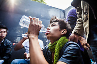 Contestants try to cool themselves down backstage at the Naga Chili Eating Competition at the Hornbill Festival in Nagaland, India. This young contestant put down 13 chilis during the competition and is now reeling from the affects of the world's hottest chili.