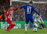 Football - 2017 / 2018 UEFA Champions League - Group C: Chelsea vs. Atletico Madrid<br /> <br /> Eden Hazard (Chelsea FC)  squares the ball as he worng foots Lucas Hernandez (Atletico Madrid) at Stamford Bridge.<br /> <br /> COLORSPORT/DANIEL BEARHAM