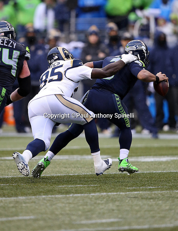 Seattle Seahawks quarterback Russell Wilson (3) is sacked by St. Louis Rams defensive end William Hayes (95) in the third quarter during the 2015 NFL week 16 regular season football game against the St. Louis Rams on Sunday, Dec. 27, 2015 in Seattle. The Rams won the game 23-17. (©Paul Anthony Spinelli)