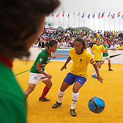 The Brazilian women's team in action while winning the Women's Homeless Football World Cup Final defeating Mexico 7-3. Sixty-four national homeless teams took part in the International football tournament staged on Copacabana beach. Rio de Janeiro. The Brazilian men made it a clean sweep for Brazil defeating Chile 6-0 in the Men's World Cup Final. The Homeless World Cup aims at beating homelessness through football and brings awareness to the one billion people who are homeless in the world today. Rio de Janeiro,  Brazil. 26th September 2010. Photo Tim Clayton.