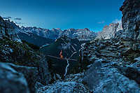 A male athlete as seen in the dawn highlining on Monte Piana, Dolomites, Italy.