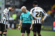 Referee Andy Woolmer moves Notts County's Jason Banton and Liam Noble back for a free kick to during the Sky Bet League 2 match between Notts County and Leyton Orient at Meadow Lane, Nottingham, England on 20 February 2016. Photo by Jon Hobley.