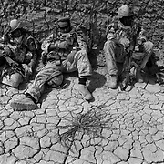 Canadian Soldiers lay in the heat taking cover behind a wall as engineers destroy multiple IED's (improvised explosive devices) set by insurgents targeting them during a multiple day operation aimed at attempting to clear the village of Chalgower in Panjwaii District, Kandahar, Afghanistan. Following this operation a brutal insurgency took hold in Chalgower and in the surrounding villages resulting in injury and death to numerous civilians, insurgents and soldiers without completely expelling the insurgents influence in the area. (Credit Image: © Louie Palu/ZUMA Press/The Alexia Foundation).June 20, 2010.Photograph taken on film exact date estimated and not known.
