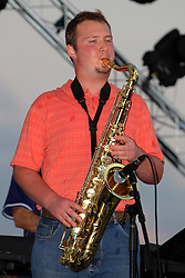 20 September 2014:   Russell Zehr.<br /> <br /> Marc Boon and the Unknown Legends perform at the Chris Brown Benefit Concert at the Corn Crib Stadium, Normal Illinois.  The band is comprised of 8 musicians: Marc Boon - front man and lead guitar, Jeff Young - drums, Ray Wiggs- keyboards, Aaron Garcia - trumpet-percussion-vocals, Burl Torner - guitar, Russell Zehr - saxaphone-guitar-keyboards-vocals, Chris Briggs - bass-vocals-keyboard, Jerry Abner - keyboards,