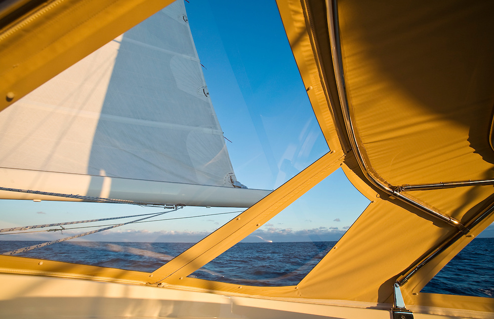 As seen from the inside of the bimini, a large sailing yacht reaches across the the north Atlantic ocean on a voyage to Europe by way of the Azores..