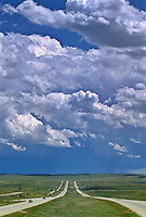 Cumulus congestus clouds over Interstate 25 on the Wyoming plains.