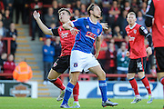 Morecambe Defender Peter Murphy beaten to the ball during the EFL Sky Bet League 2 match between Morecambe and Carlisle United at the Globe Arena, Morecambe, England on 8 October 2016. Photo by Pete Burns.