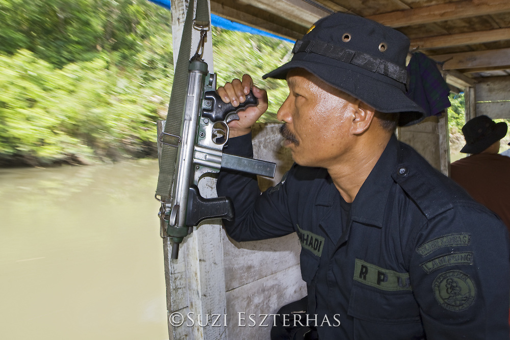Anti-poaching unit member on patrol along Kambas River<br /> Way Kambas National Park, Indonesia
