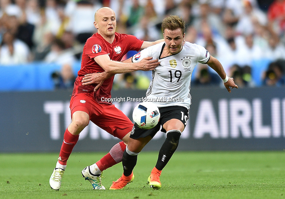 2016.06.16 Saint-Denis<br /> Pilka nozna Euro 2016<br /> mecz grupy C Polska - Niemcy<br /> N/z Michal Pazdan, Mario Gotze<br /> Foto Lukasz Laskowski / PressFocus<br /> <br /> 2016.06.16 Saint-Denis<br /> Football UEFA Euro 2016 group C game between Poland and Germany<br /> Michal Pazdan, Mario Gotze<br /> Credit: Lukasz Laskowski / PressFocus