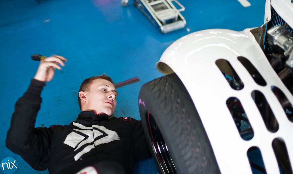 Daniel Hemric (21), from Kannapolis, works on his car during the Big Money 100 at Charlotte Motor Speedway Monday afternoon (photo by James Nix)