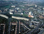 Nederland, Zuid-Holland, Leiden, 01-12-2005; luchtfoto (25% toeslag); hoogbouw in Morskwartier, jaren zeventig stadsuitbreiding; bovenste deel van de foto: overzicht van het Bio Science Park Leiden, met midden rechts het Museum Naturalis (met oranje muur affiche) verbonden door middel van een luchtbrug met het historische Pesthuis (gesloten blok); planologie, stadsvernieuwing; zie ook andere (lucht)foto's.foto Siebe Swart