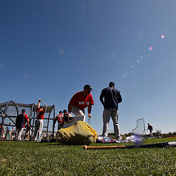 February 19, 2011; Fort Myers, FL, USA; Boston Red Sox first baseman Kevin Youkilis (20) grabs a drink from a cooler following batting practice during spring training at the Player Development Complex.  Mandatory Credit: Derick E. Hingle