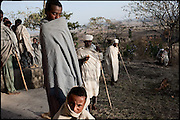 "Members of a small community, after the Orthodox Church service on Sunday. North West of Ethiopia, on sunday, Febrary 15 2009.....In a tangled mingling of tradition and culture, in the normal place of living, in a laid-back attitude. The background of Ethiopia's ""child brides"", a country which has the distinction of having highest percentage in the practice of early marriages despite having a law that establishes 18 years as minimum age to get married. Celebrations that last days, their minds clouded by girls cups of tella and the unknown for the future. White bridal veil frame their faces expressive of small defenseless creatures, who at the age ranging from three to twelve years shall be given to young brides men adults already...To protect the identities of the recorded subjects names and specific places are fictional."