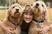 Goldendoodles are adorable in this family portrait.
