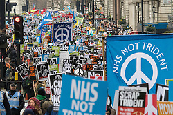 London, February 27th 2016. A large banner demands that funding for Trident is diverted to the NHS during CND's march and rally opposing the UK's Trident nuclear weapons programme. <br /> &copy;Paul Davey<br /> FOR LICENCING CONTACT: Paul Davey +44 (0) 7966 016 296 paul@pauldaveycreative.co.uk
