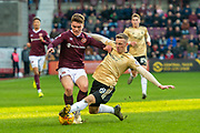Lewis Ferguson (#19) of Aberdeen FC tackles Euan Henderson (#41) of Heart of Midlothian FC during the Ladbrokes Scottish Premiership match between Heart of Midlothian FC and Aberdeen FC at Tynecastle Stadium, Edinburgh, Scotland on 29 December 2019.