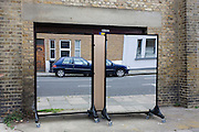Mirror panels outside a community centre in a Brixton backstreet, south London.