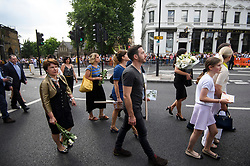 © Licensed to London News Pictures. 03/06/2018. London, UK. Family of the victims make their way to a minutes silence for the victims of the 2017 London Bridge Terror attack, held on London Bridge. Eight people were killed and 48 were injured when a van was deliberately driven into pedestrians on London Bridge. Three occupants then ran to the nearby Borough Market area carrying knives and fake explosives. Photo credit: Ben Cawthra/LNP
