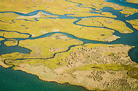 a aerial view of the intircate labrynth of marsh islands and tidal creeks behind Portsmouth Island of Cape Lookout National Seashore on the Outer Banks