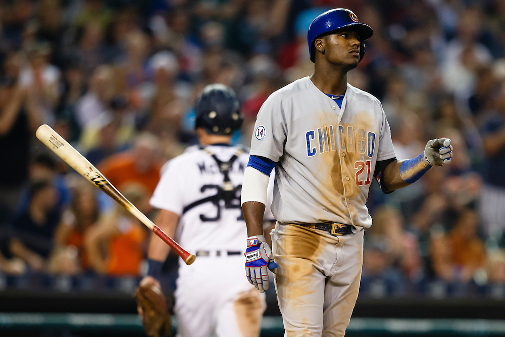 Jun 9, 2015; Detroit, MI, USA; Chicago Cubs right fielder Junior Lake (21) tosses his bat after striking out in the seventh inning against the Detroit Tigers at Comerica Park. Mandatory Credit: Rick Osentoski-USA TODAY Sports