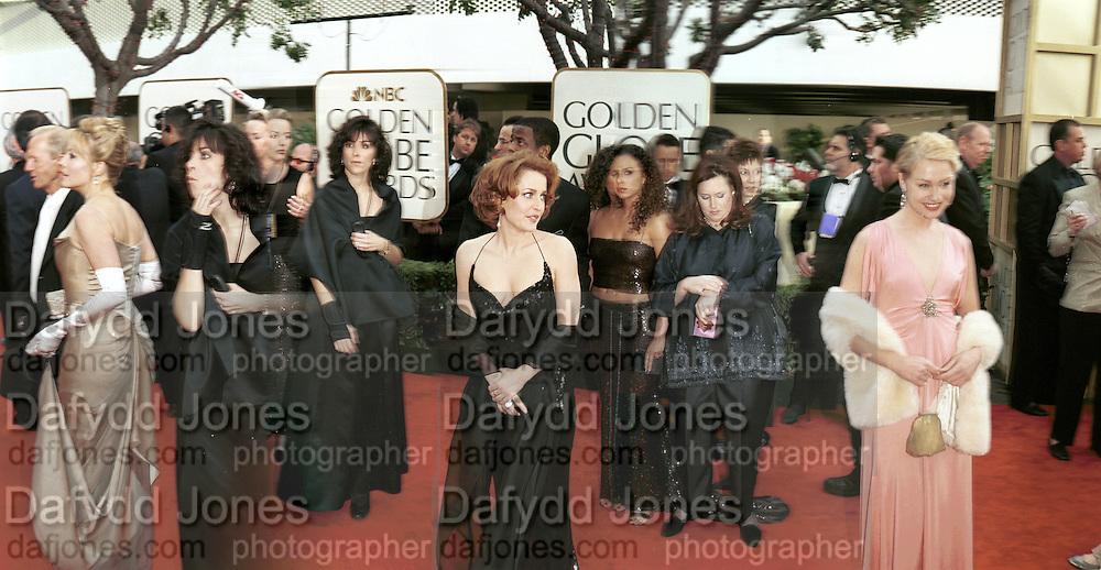 Gillian Anderson in centre. Portia de Rossi on right.  Golden Globes. Beverley Hilton. 21 January 2001. © Copyright Photograph by Dafydd Jones 66 Stockwell Park Rd. London SW9 0DA Tel 020 7733 0108 www.dafjones.com