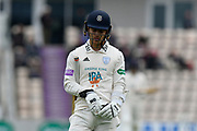 Wicket - Lewis McManus of Hampshire walks back to the pavilion after being dismissed by Joe Leach of Worcestershire during the Specsavers County Champ Div 1 match between Hampshire County Cricket Club and Worcestershire County Cricket Club at the Ageas Bowl, Southampton, United Kingdom on 13 April 2018. Picture by Graham Hunt.