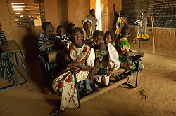 Children in a classroom in the  village of Intedeyne March 15, 2007.    the challenge to educate children in Mali still exists and particularly for girls. Female literacy rates never reach even 50 percent of male literacy rates. Mali has the highest percentage of people living below the poverty line in any country in the world. Ninety percent of Malians survive on less than two dollars a day.
