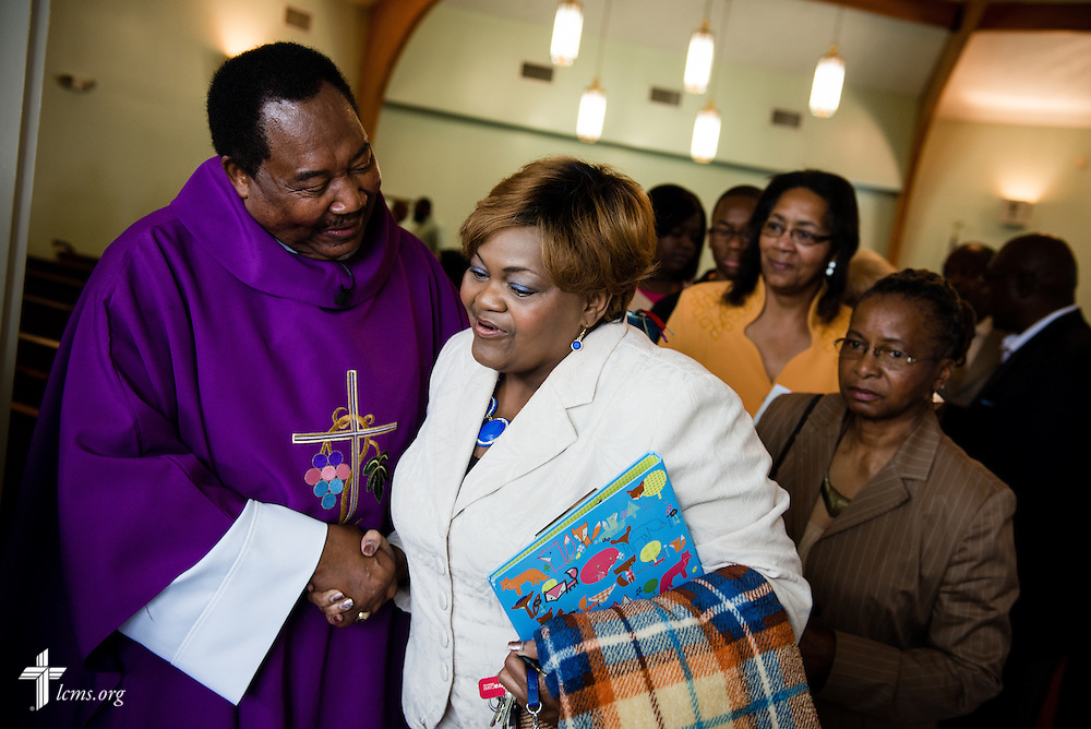 The Rev. Ulmer Marshall greets Valarie Floyd-Bridges  following worship at Trinity Lutheran Church on Sunday, April 6, 2014, in Mobile, Ala. LCMS Communications/Erik M. Lunsford