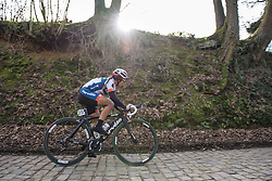 Carmen Small charges across the Kerkstraat cobbles as the sun gets low in the sky - 2016 Omloop van het Hageland - Tielt-Winge, a 129km road race starting and finishing in Tielt-Winge, on February 28, 2016 in Vlaams-Brabant, Belgium.