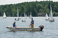 Catherine McLaughlin and Owen Carey-Hatch set the buoy's in Saunders Bay for the annual Lake Winnipesaukee Sailing Association Regatta Thursday morning.  (Karen Bobotas/for the Laconia Daily Sun)