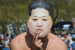 © Licensed to London News Pictures. 20/04/2019. London, UK. A man wearing Supreme Leader of North Korea, Kim Jong-un face mask smokes cannabis as thousands of revellers gather in London's Hyde Park as part of '4/20 Day', an unofficial International Weed Day, an event that takes place every year on 20 April for people to smoke cannabis without been detained. Attendees are calling on the Government to decriminalise Class B drug and raise awareness about the drug. Photo credit: Dinendra Haria/LNP